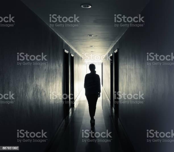 Women are walking alone in the darklight at the end of the tunnel picture id887651992?b=1&k=6&m=887651992&s=612x612&h=m8cegq7f2am8l78ybcuzgddllr2w86jeu4x9vpqeiba=