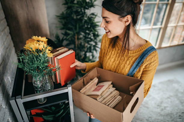 Women arranging stuff in new apartment Young women unpacking in new rented apartment arrange stock pictures, royalty-free photos & images