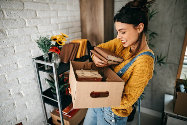 Women arranging stuff in new apartment stock photo