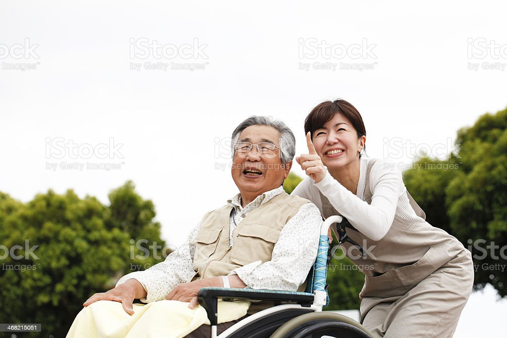 Women assisted wheelchair stock photo