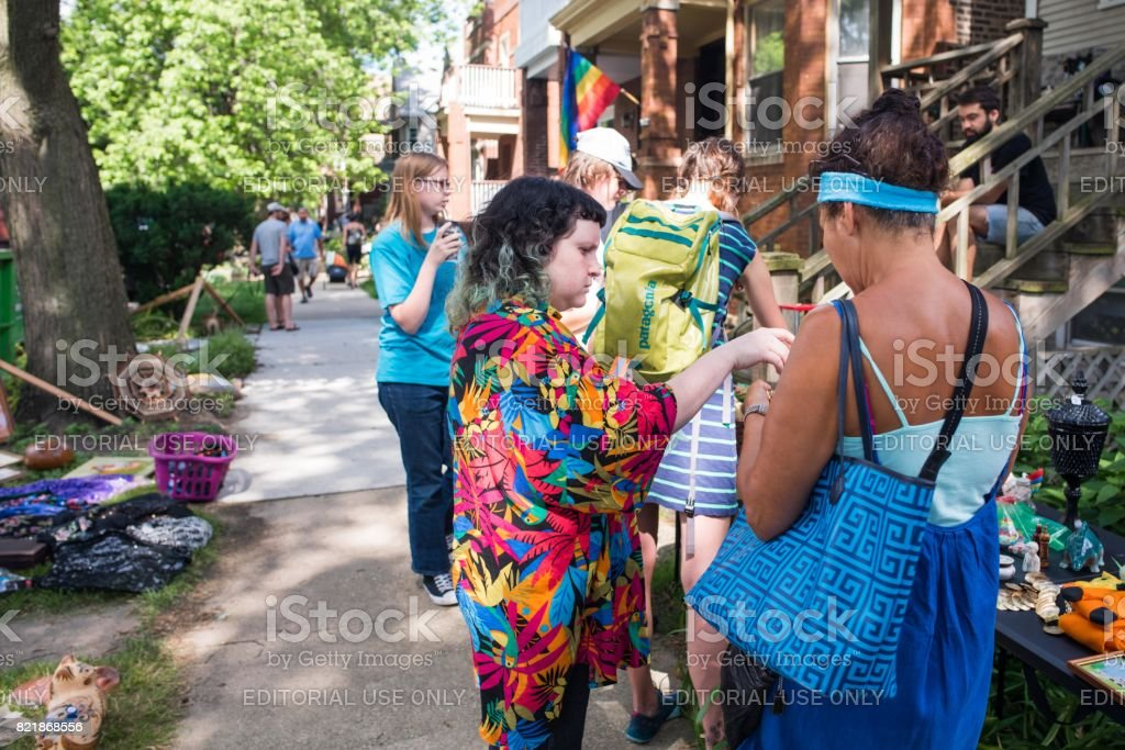 Women at a yard sale in Chicago stock photo