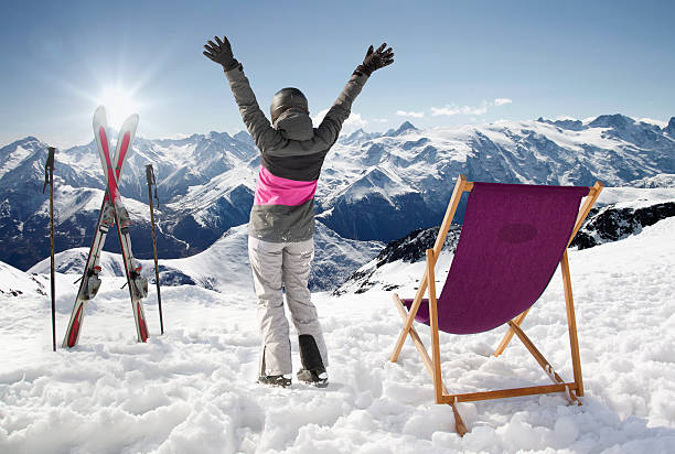 Women at mountains in winter with sun-lounger,France high mountains Women at mountains in winter with sun-lounger,France mountains apres ski stock pictures, royalty-free photos & images