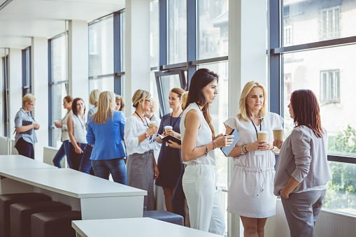 Women At Seminar Having A Coffee Break Stock Photo - Download Image Now