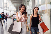 Women at shopping mall in Thailand