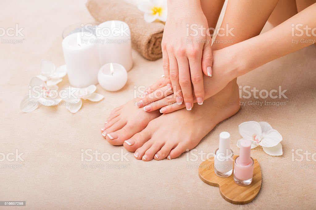 Women at spa salon after manicure and pedicure stock photo