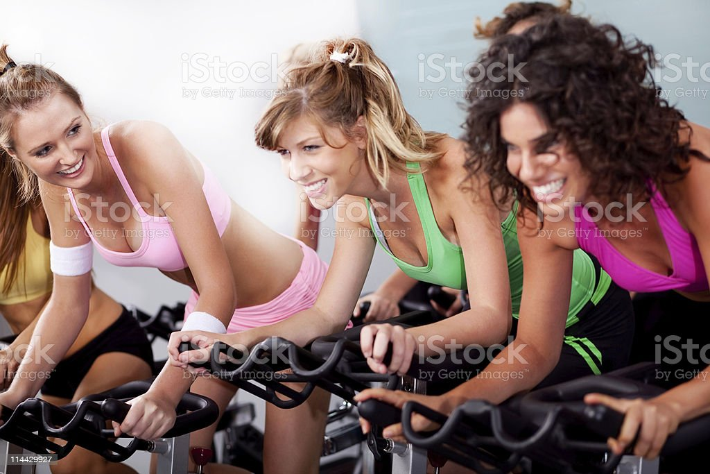 women at the gym doing cardio exercises stock photo