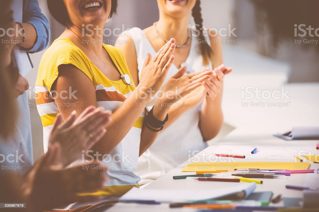 Women at the seminar clapping hand Group of happy women attending a seminar, clapping hands. Close up of hands. 2015 Stock Photo