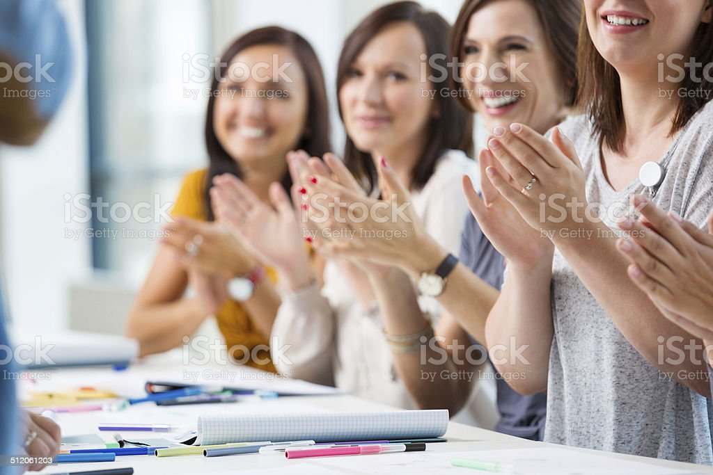 Women at the seminar Group of women attending a seminar, clapping hands. Close up of hands. 30-39 Years Stock Photo