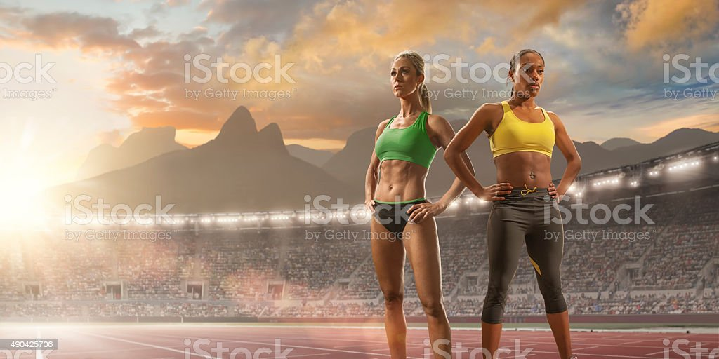 Women Athletes Standing in Olympic Stadium in Rio stock photo