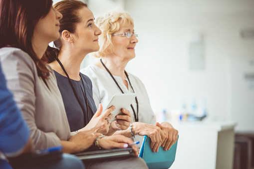 Women Attending A Seminar Stock Photo - Download Image Now