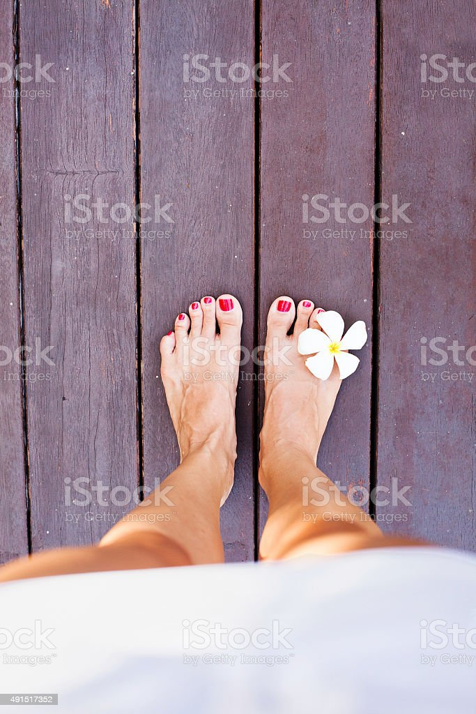 Women bare feet standing on a floor stock photo