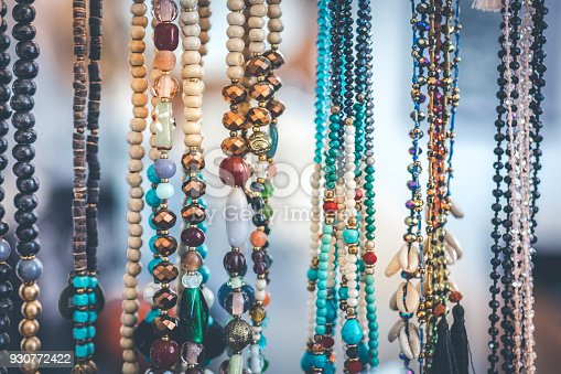 istock Women beads and necklace in jewerly market. Bali island 930772422