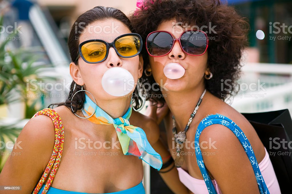 Women blowing bubble Gum royalty-free stock photo