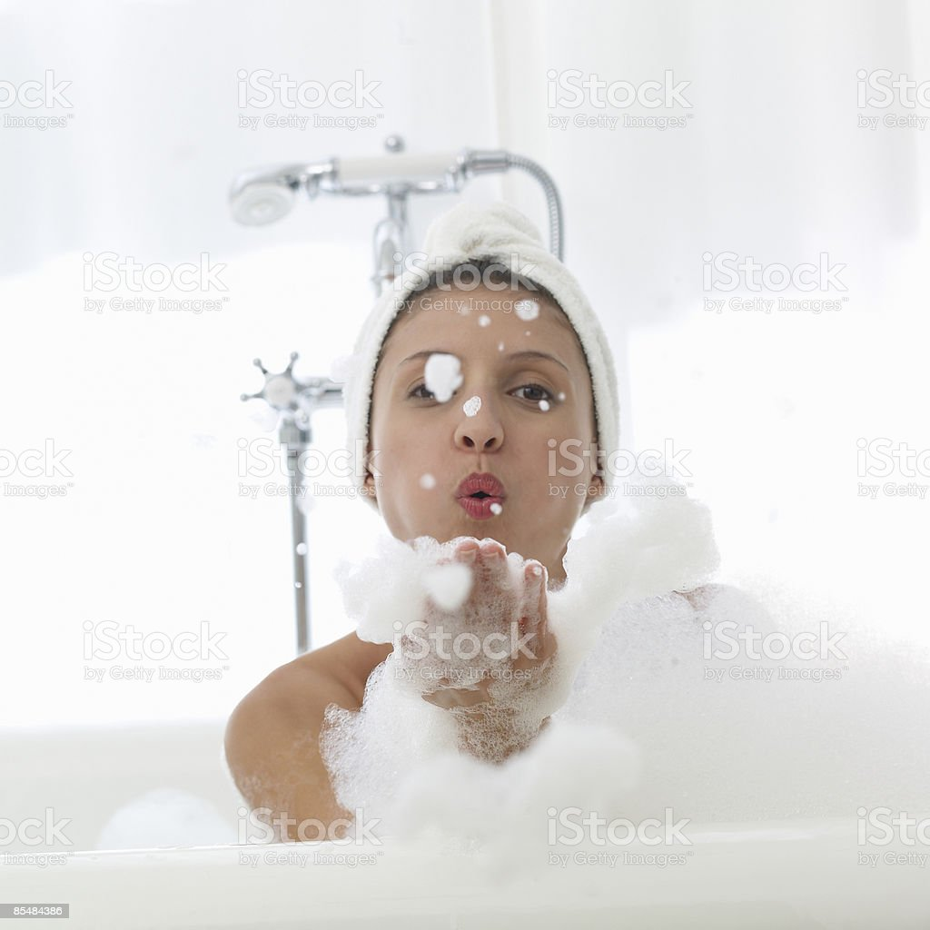 Women blowing bubbles in bath royalty-free stock photo