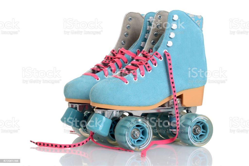 women blue quad roller skates stock photo