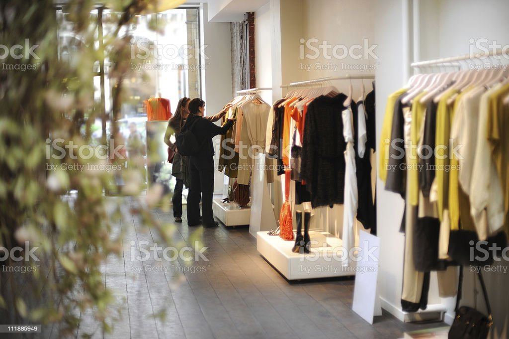 Women Boutique Dress Shopping in Paris France stock photo