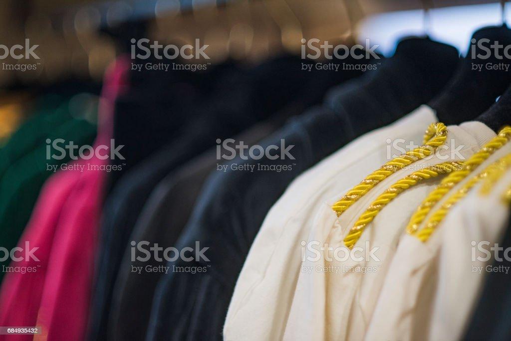 Women boutique shop concept - colorful clothing on hangers. Lizenzfreies stock-foto