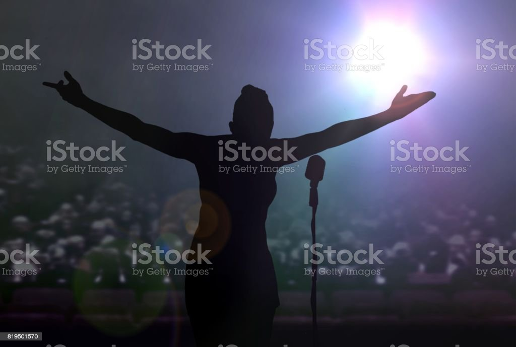 Women bowing on stage after a concert stock photo
