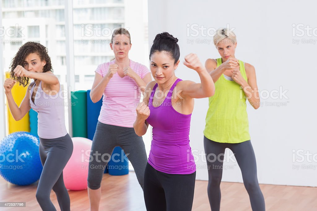 Women boxing at fitness studio stock photo