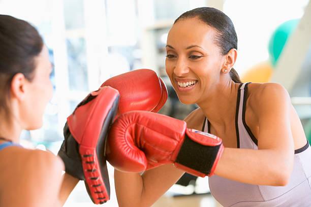 Women Boxing At Gym stock photo