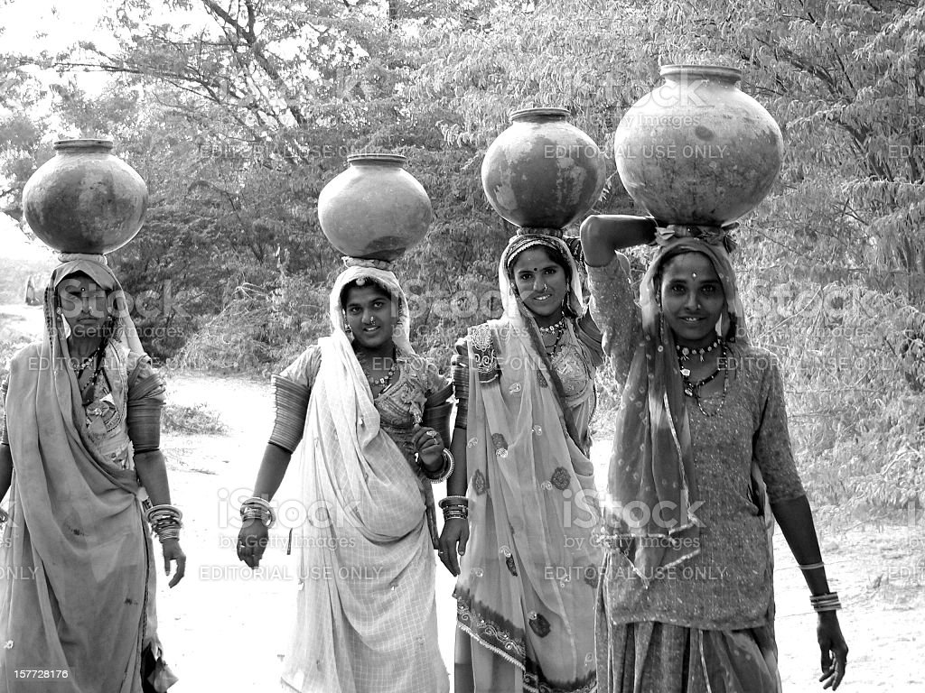 Women bringing water to village Chandelao in Rajasthan, India royalty-free stock photo