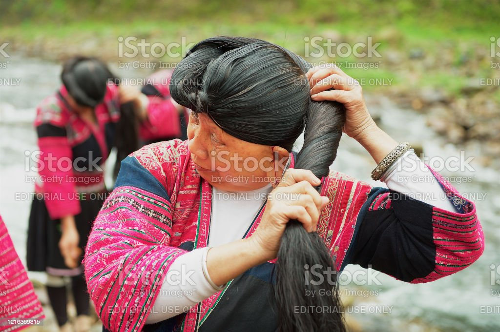 Women Brush And Style Long Hair In Longji Village China Stock Photo Download Image Now Istock