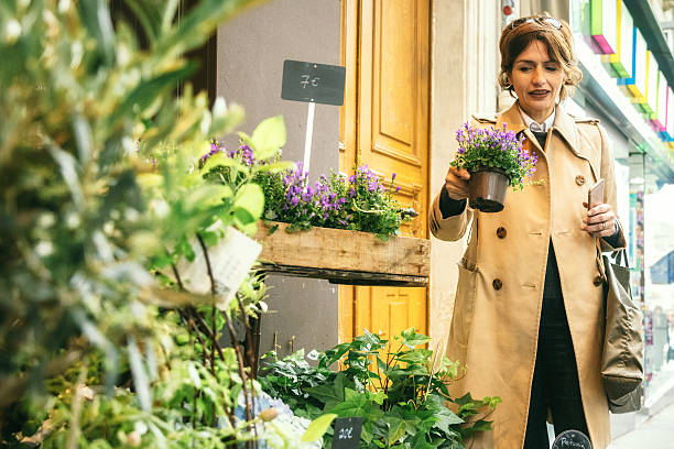 women buying flowers in the streets of Paris, France stock photo