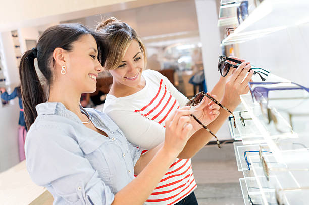 Women buying sunglasses at the optician's shop stock photo
