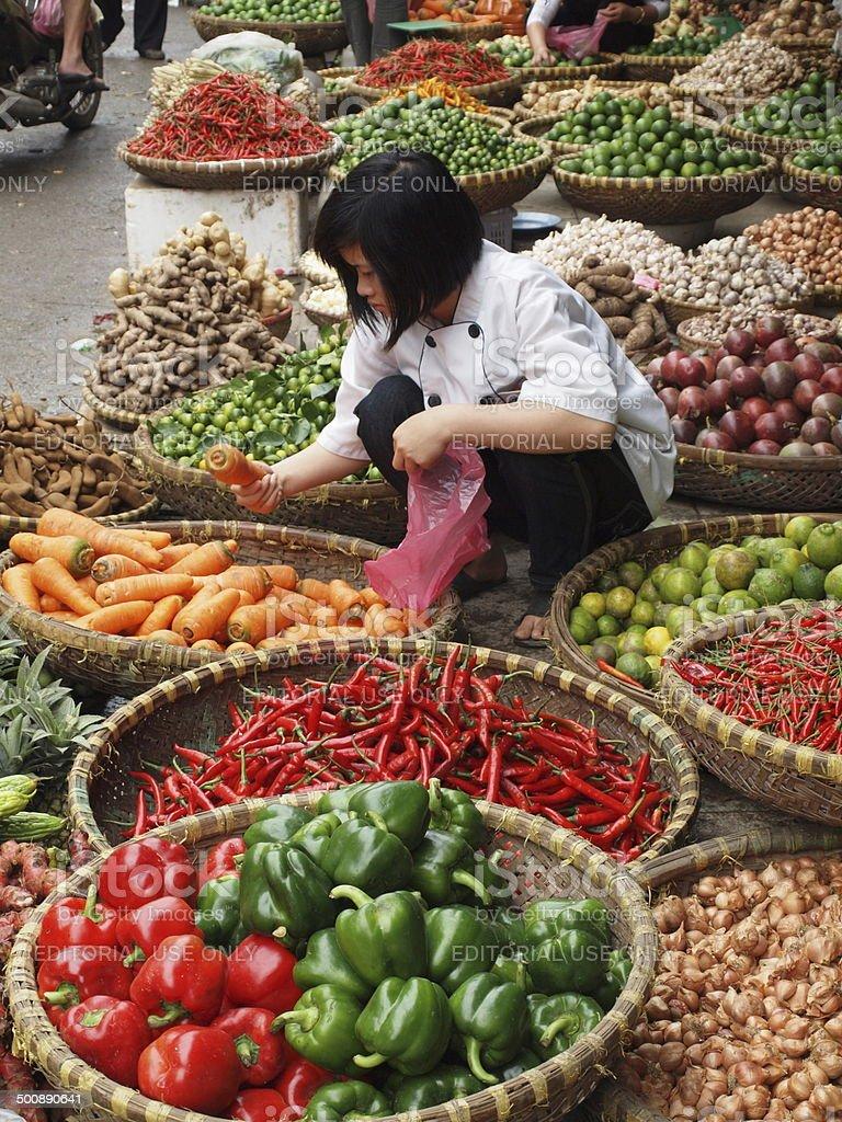 Women buys at an Asian food market stock photo