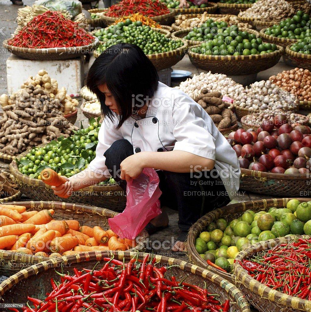 Women buys food at an Asian food market stock photo