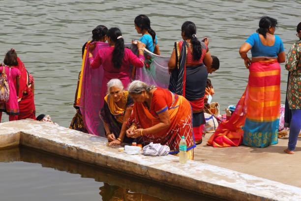 Women by Pushkar lake stock photo