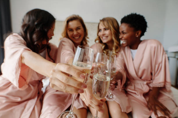 Women celebrate a bachelorette party of bride stock photo