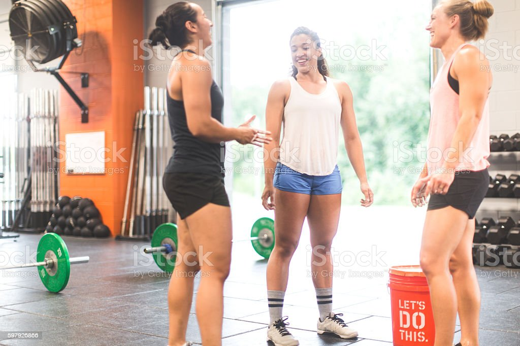 Women chalk hands before a weightlifting cross training workout stock photo