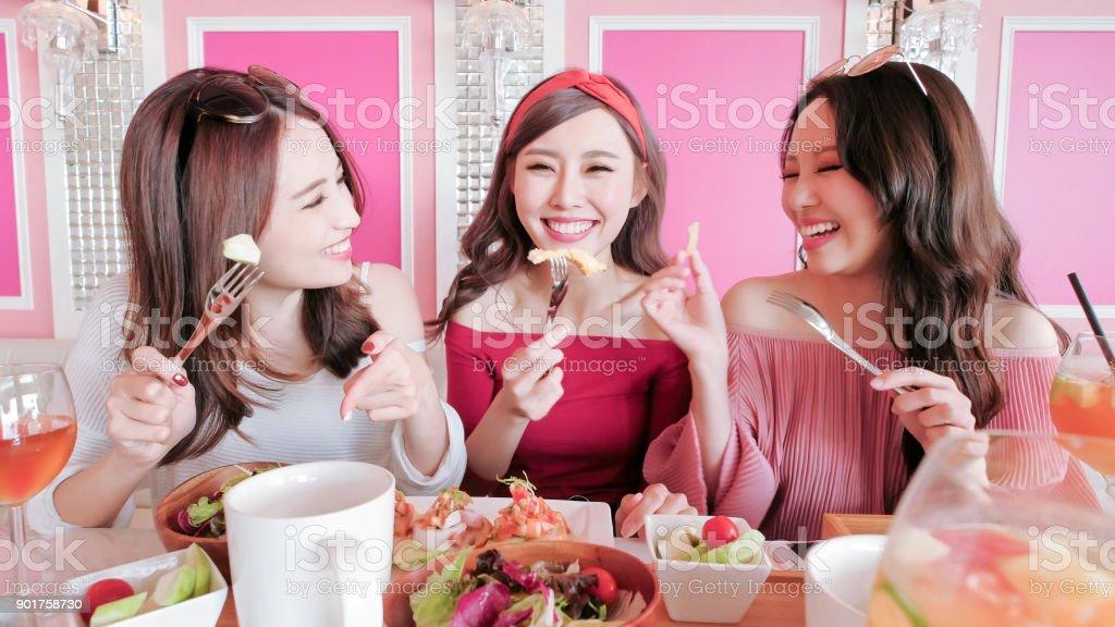 women chatting in restaurant stock photo