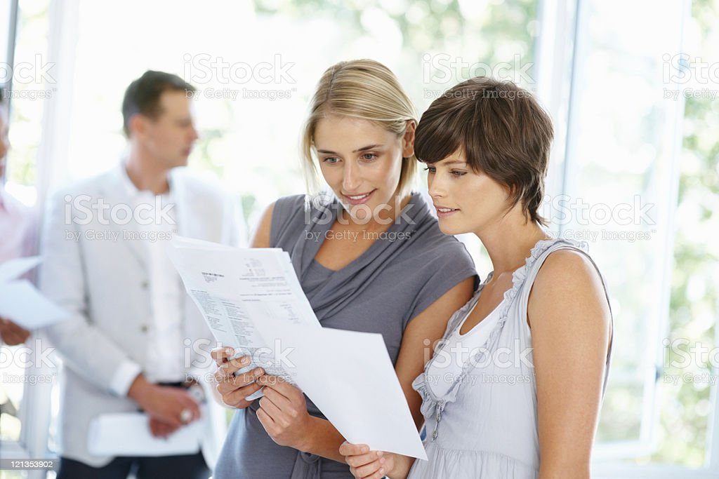 Women checking business documents royalty-free stock photo