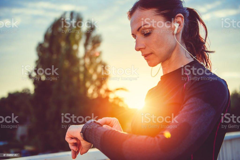 Women checking fitness tracker stock photo