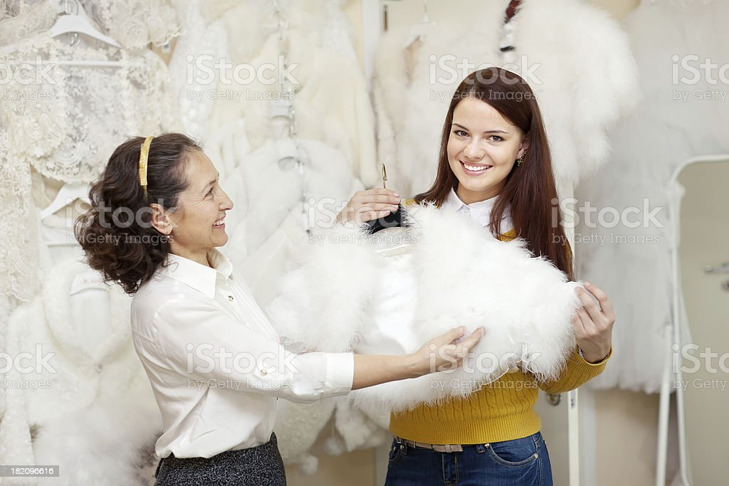 women chooses bridal outfit at wedding store royalty-free stock photo