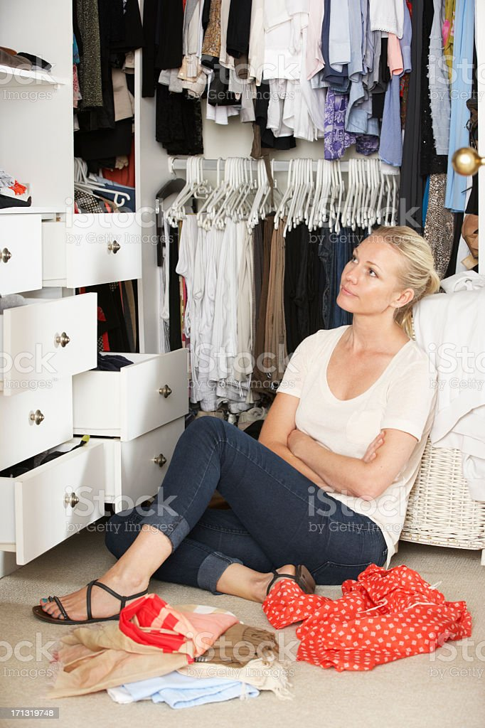 Women Choosing Clothes From Wardrobe In Bedroom royalty-free stock photo