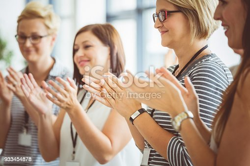 1028234706 istock photo Women clapping hands during seminar 933454878