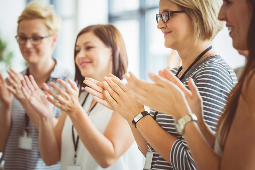 Women Clapping Hands During Seminar Stock Photo - Download Image Now
