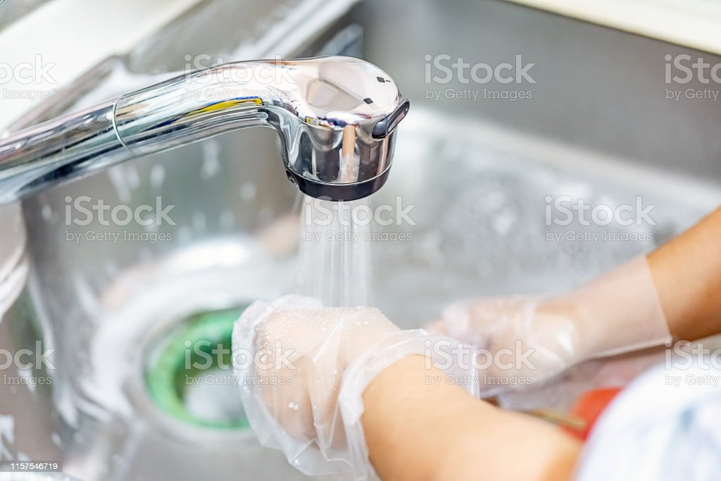 Women Cleaning The Kitchen Sink With Sponge Stock Photo Download Image Now Istock