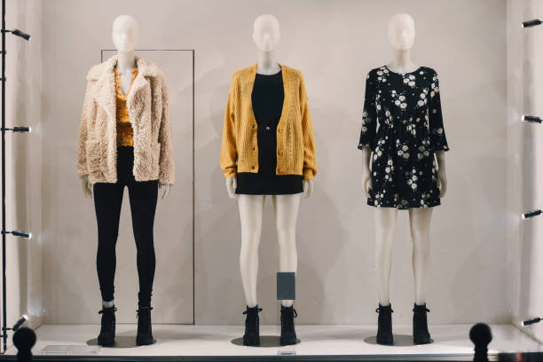 Women clothing on mannequins in a store in Paris, 2018. Women clothing on mannequins in a store in Paris, 2018. retail equipment stock pictures, royalty-free photos & images