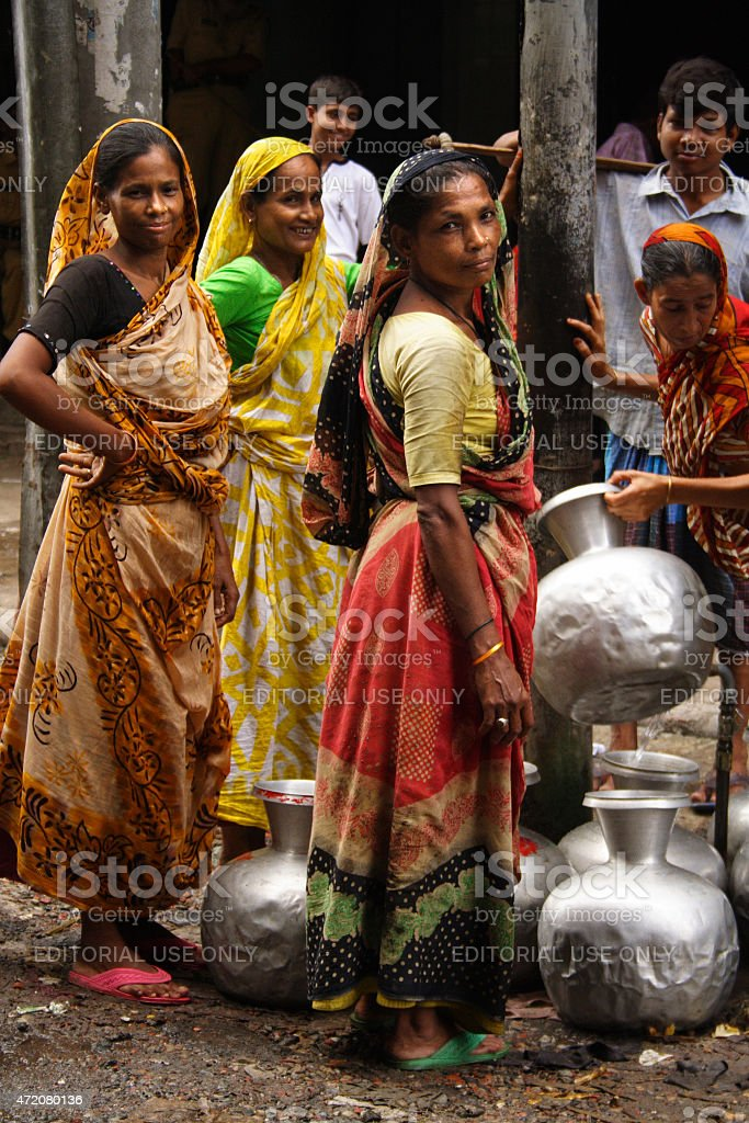 Women collecting water stock photo