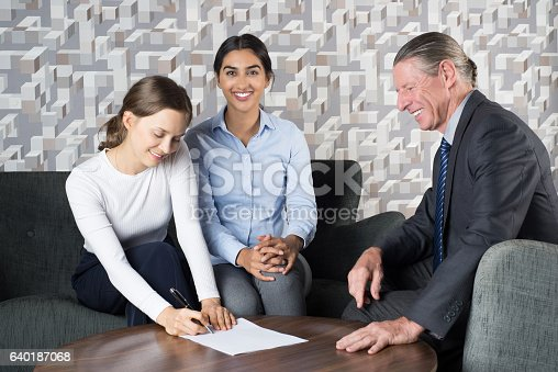 istock Women Couple Signing Contract and Senior Agent 640187068