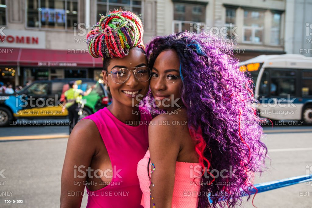 Women couple smiling at NYC Pride Parade stock photo