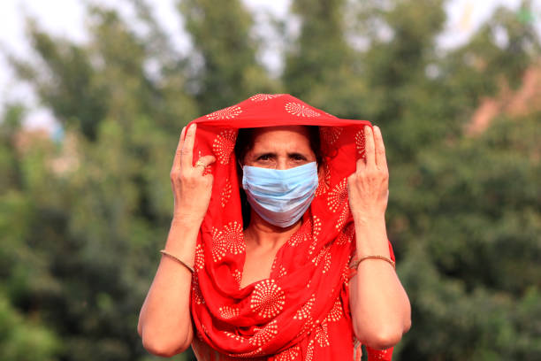 Women covering her face with pollution mask for protection from viruses, COVID-19 stock photo