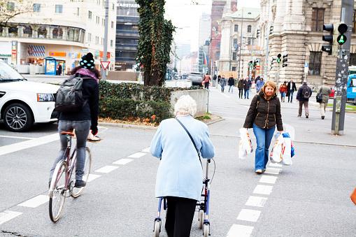 Women crossing crosswalk in Munich