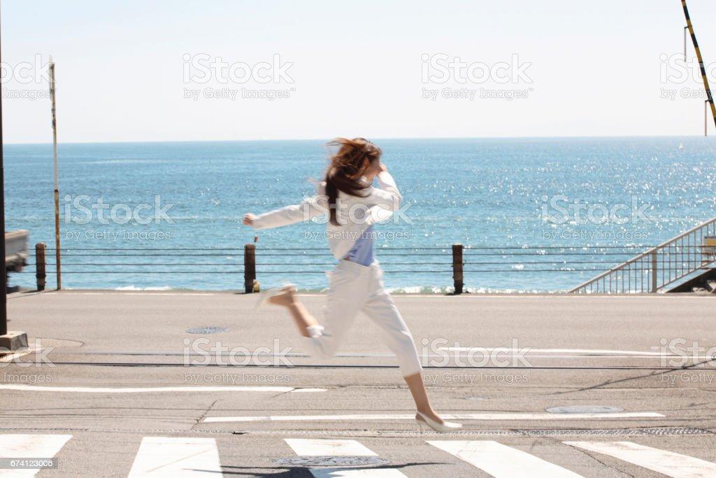 Women crossing the street stock photo