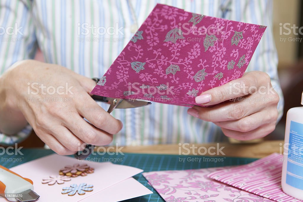 Women cutting scrapbook paper for a project stock photo