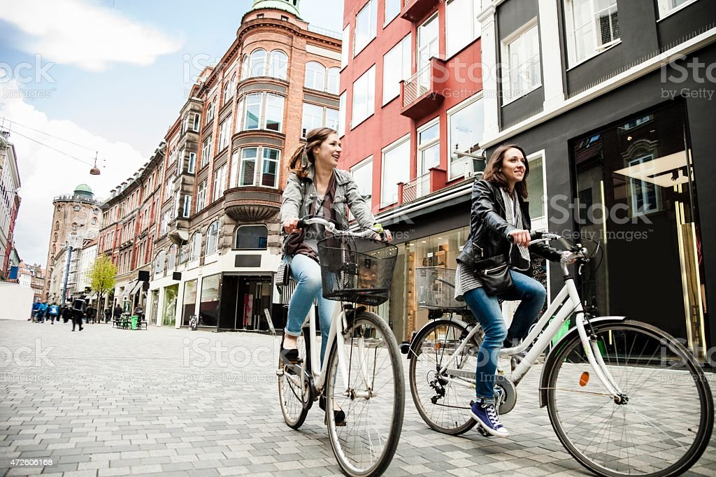 Women cycling in Copenhagen stock photo